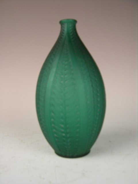 "23: R. LALIQUE ""ACACIA"" VASE IN GREEN GLASS."