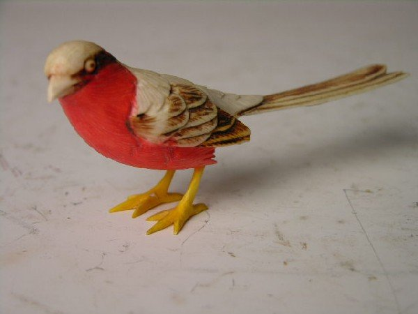 "1: IVORY POLYCHROMED BIRD.  HEIGHT 1 3/4""."