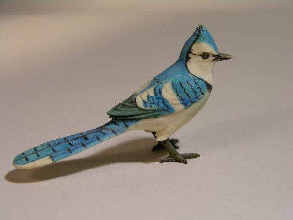 "3: IVORY POLYCHROMED BIRD. HEIGHT 1 5/8""."