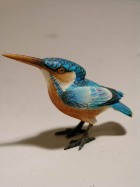 "8: IVORY POLYCHROMED BIRD.  HEIGHT 1 3/4""."
