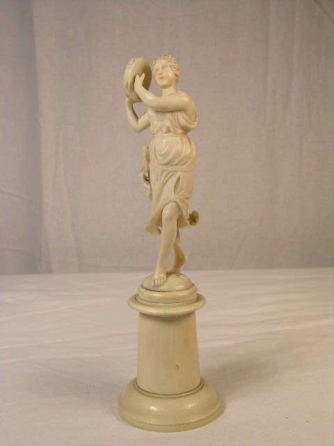 23: EUROPEAN IVORY CARVING OF BAREFOOTED WOMAN PLAYING