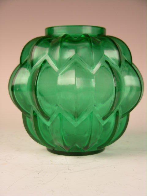 "12: R. LALIQUE ""NIVERNAIS"" VASE IN GREEN GLASS."