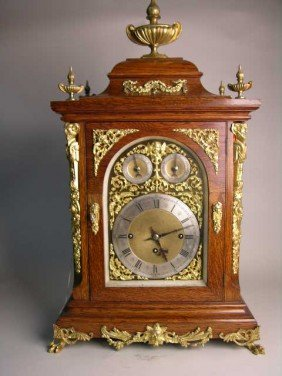 4: ENGLISH OAK  CHIMING BRACKET  CLOCK WITH BRASS DIALS