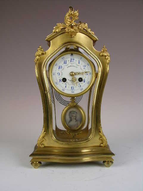 11: FRENCH MANTLE CLOCK IN A GOLD CASE WITH  BEVELED GL