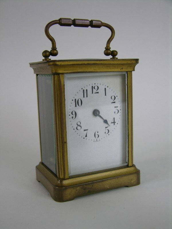 "18: BRASS CARRIAGE CLOCK. 4 1/4"" HIGH."