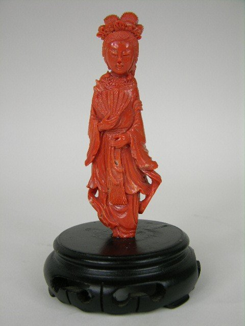 3: CORAL FIGURE OF A LADY WITH A FAN.
