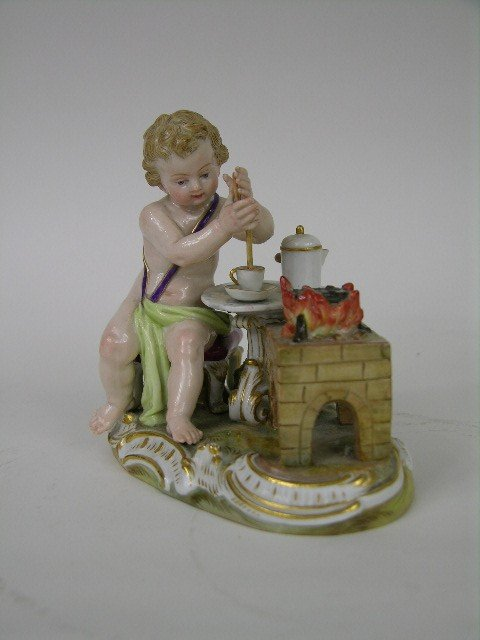17A: MEISSEN FIGURINE OF A SMALL CHILD AT A TABLE.