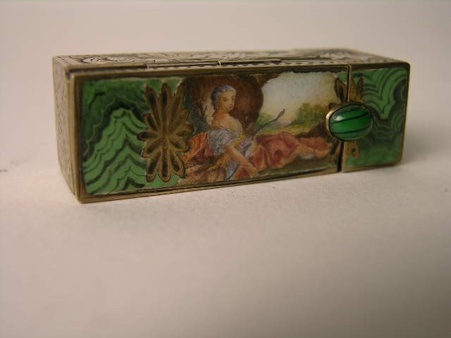 17: ANTIQUE STERLING SILVER ENAMELED COMPACT.