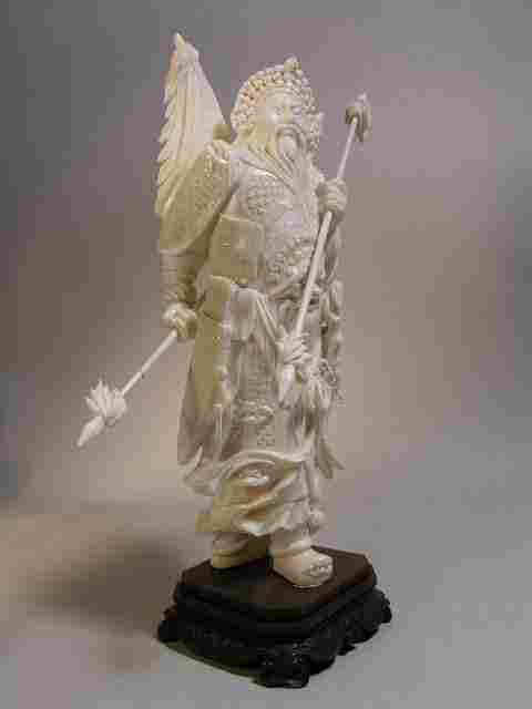 IVORY CARVING OF A WARRIOR. OVERALL HEIGHT 11