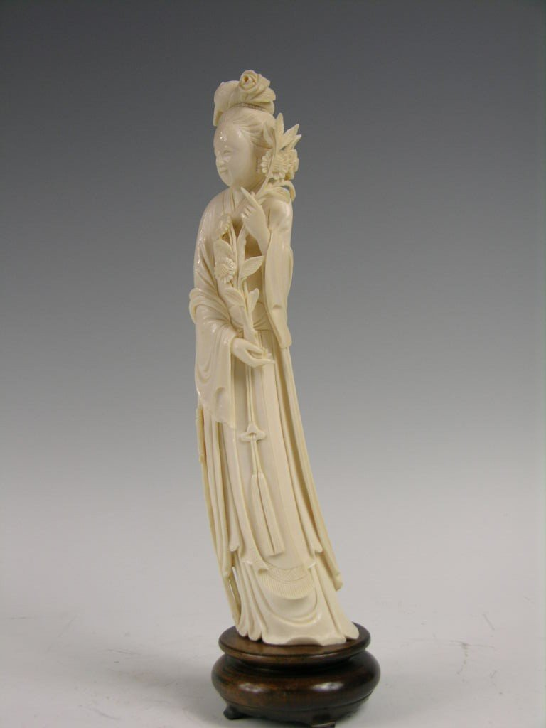 66: IVORY FIGURE OF A BEAUTY HOLDING A BUNCH OF ROSES.
