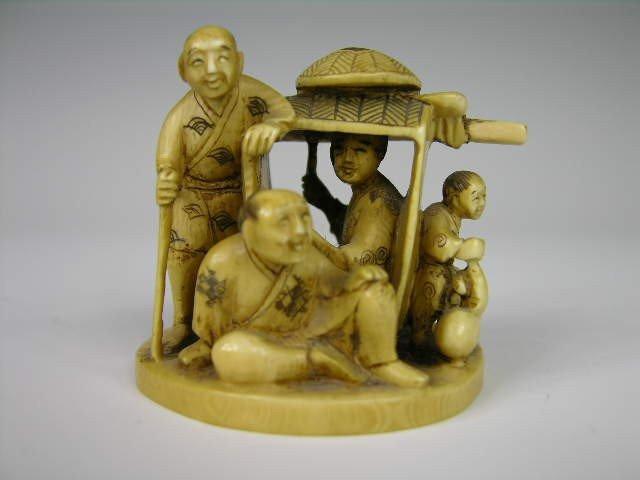 11: FINELY CARVED  OKIMONO GROUP.