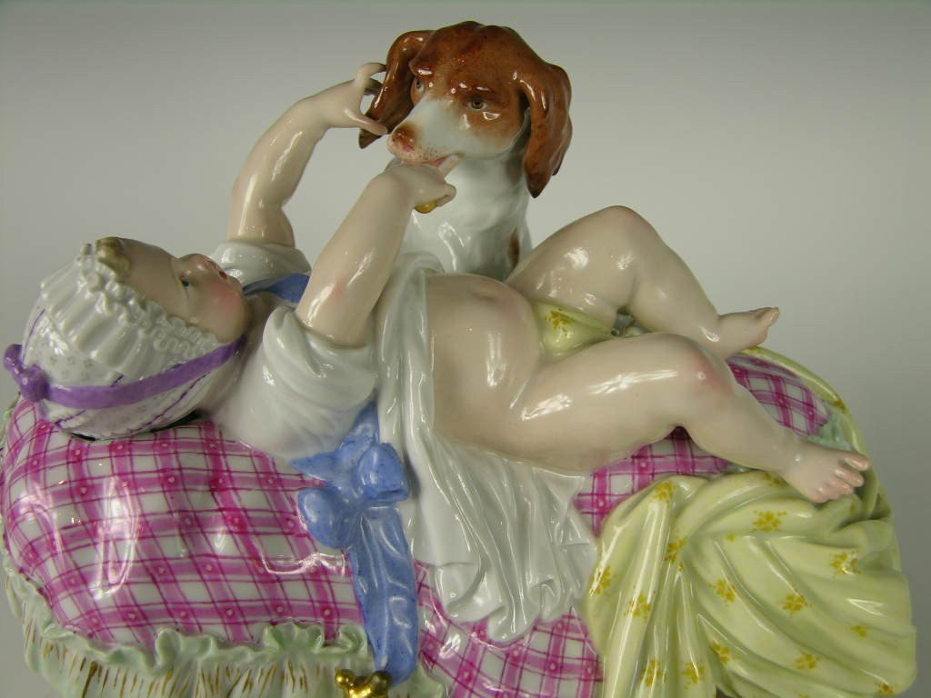 224: 19TH CENTURY MEISSEN FIGURE OF BABY AND DOG.
