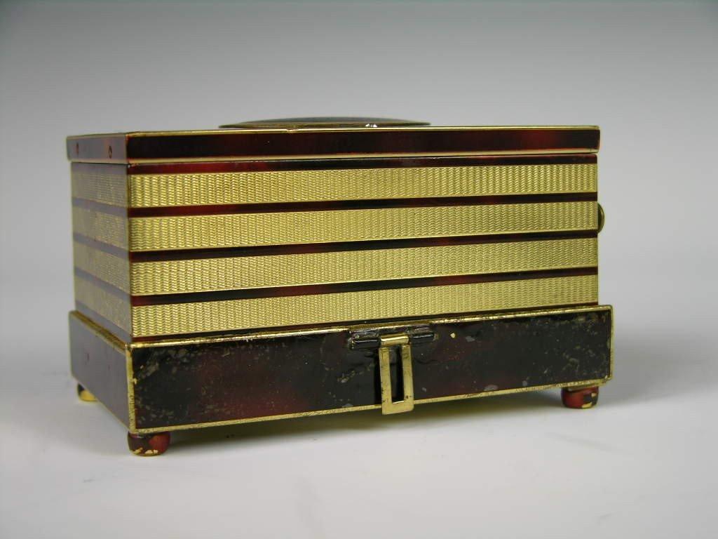 7: MECHANICAL SINGING BIRD BOX.
