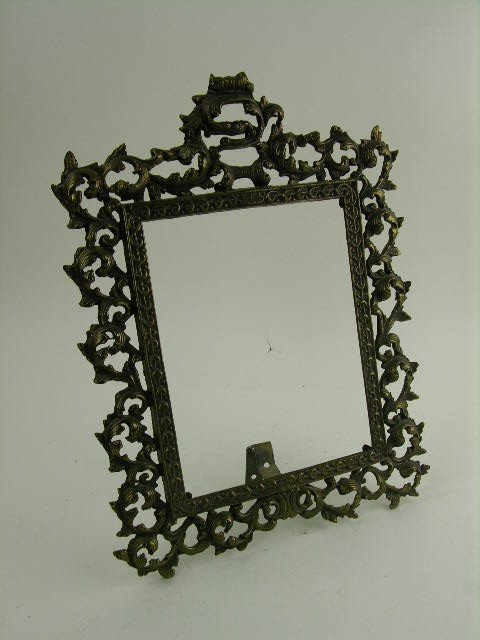 11: Victorian style brass picture frame.