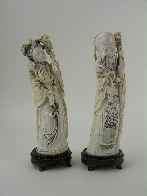24: A pair of carved Chinese ivory figures.