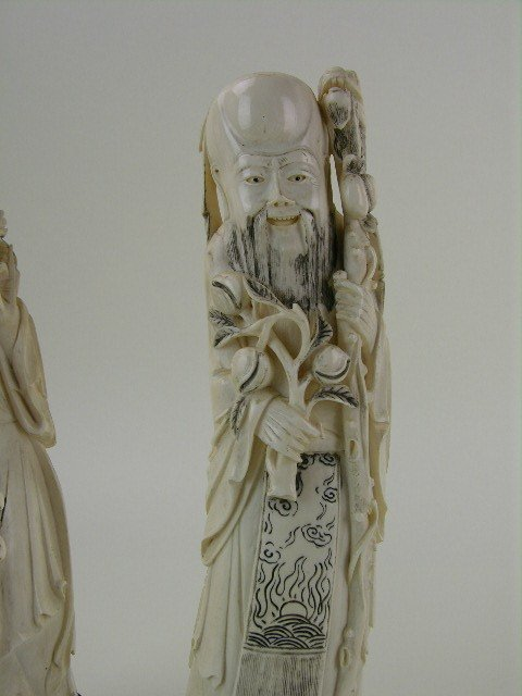24: A pair of carved Chinese ivory figures. - 2