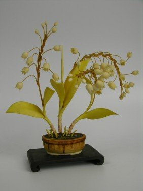 Chinese Carved And Polychrome Ivory Flower Group.