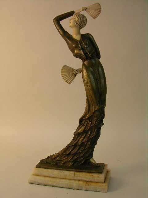144: A very nice patinated bronze female dancer.