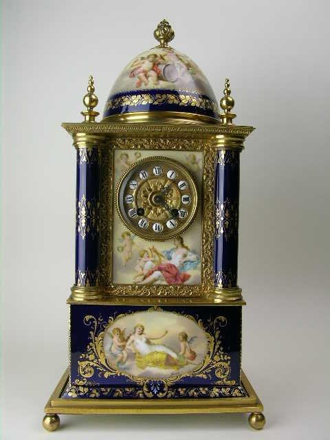 157: 19 th Century Royal Vienna mantle clock.