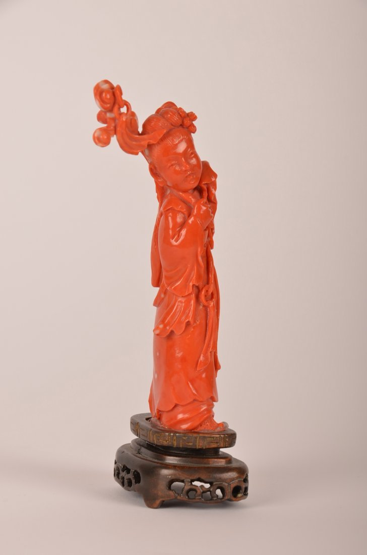 5: Chinese carved coral figure of a lady with flowers.