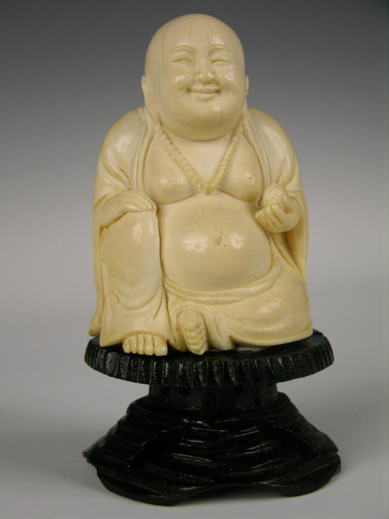 9: Chinese carved ivory figure of Buddha.