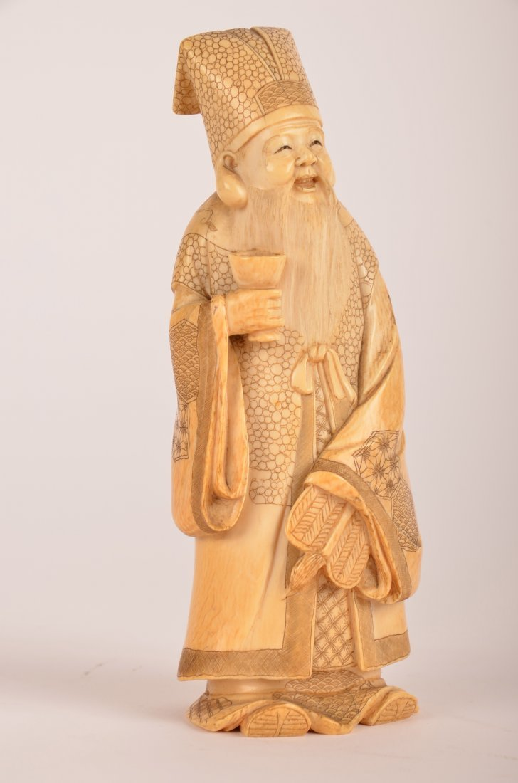 10: Chinese carved ivory figure of a man with cup.