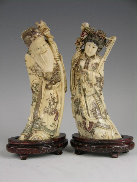 11: A pair of Chinese ivory figures.