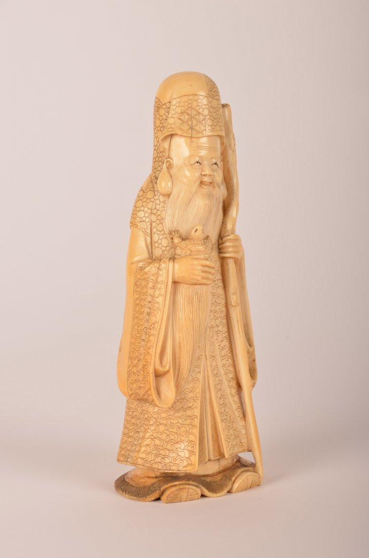 12: Carved Chinese ivory figure of a man with turtle.