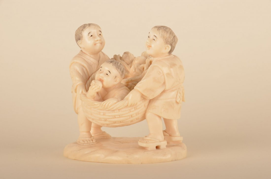 13: Chinese carved ivory group of two men with boy in l