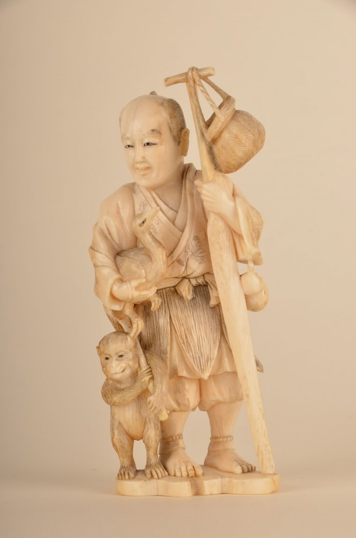 14: Chinese carvse carved ivory figure of a man with mo
