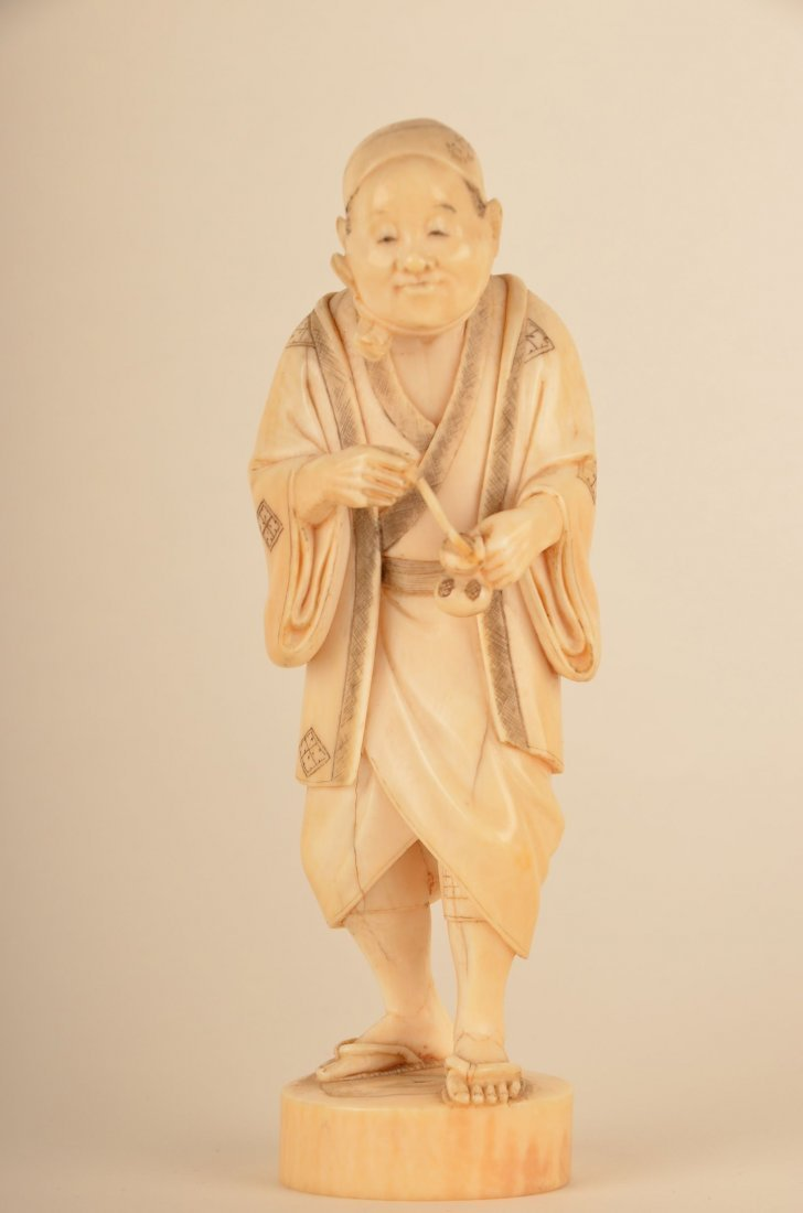 15: Chinese carved ivory figure of a man with medicine