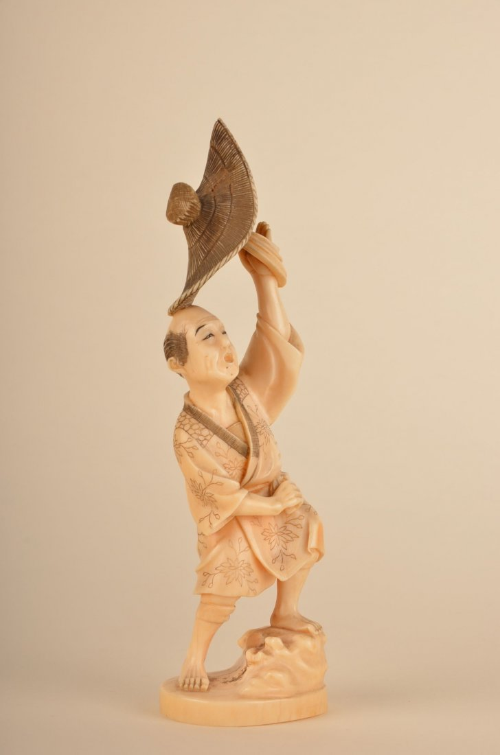 16: Chinese carved ivory figure of a man with straw hat
