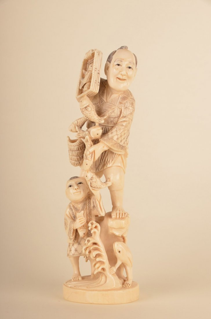 17: Chinese carved ivory group of fish seller with boy