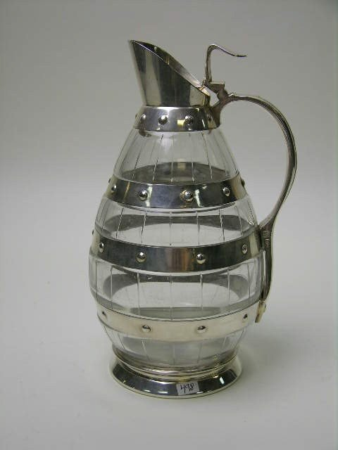 23: WMF silver plated claret jug with glass barrel form