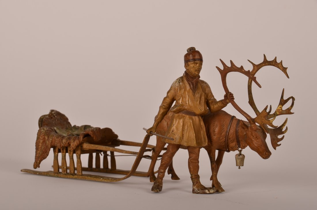 112: Bergman bronze figure of a fisher with his elk pul