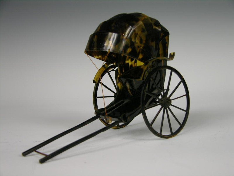 67: Antique natural shell rickshaw.