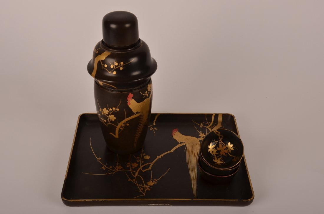 68: Japanese lacquer and gilt painted sake set comprisi