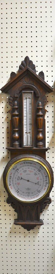 11: English Oak case Barometer and therometer.
