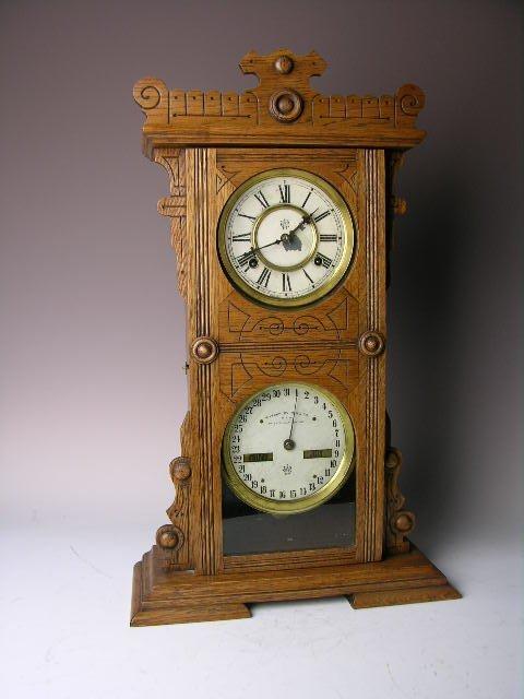 12: Antique wood mantle clock by Waterbury Clock Compan