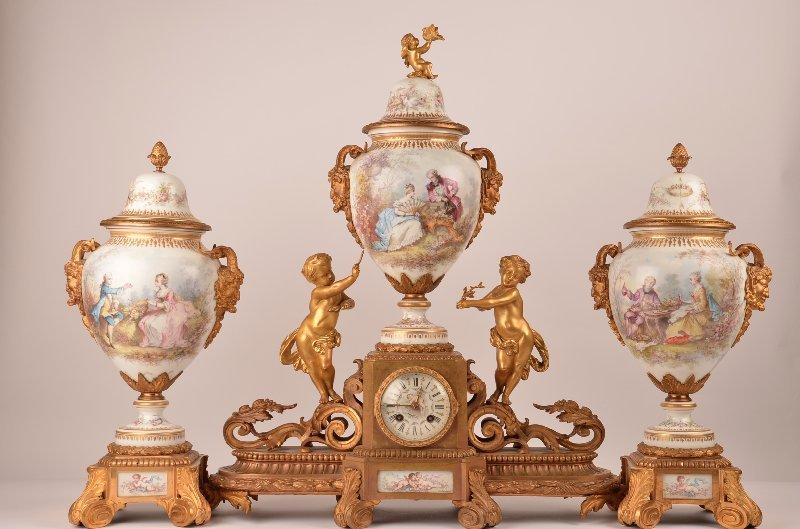 43: Sevres three piece ormolu clock garniture.