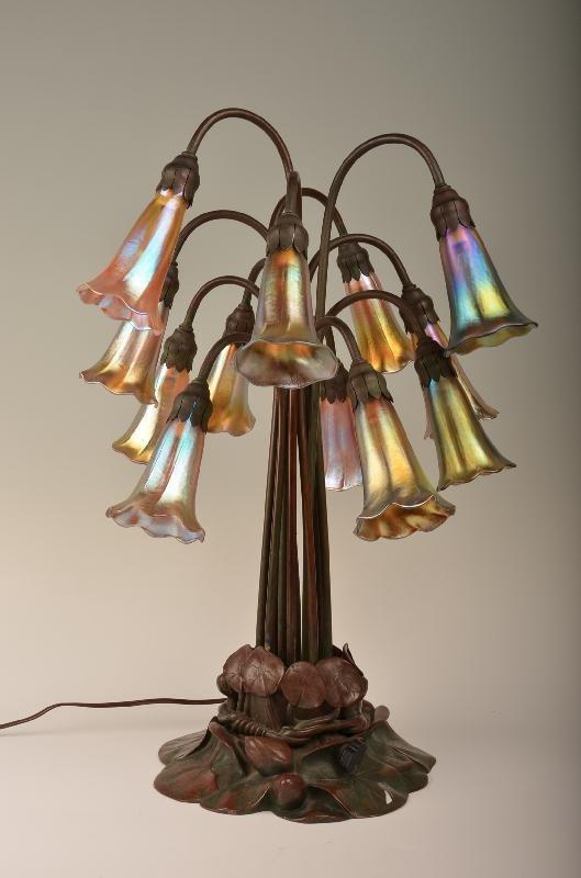 62: Tiffany Studios 12 Light Lilly Table Lamp. The plat