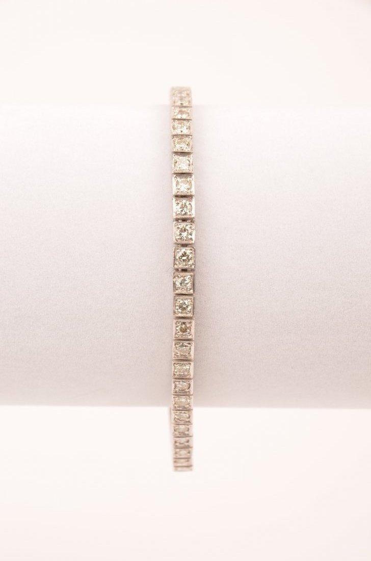 1: Platinum and diamond line or tennis bracelet, compri
