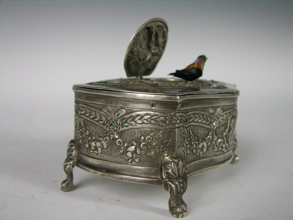 34: Mechanical sterling silver singing bird box.
