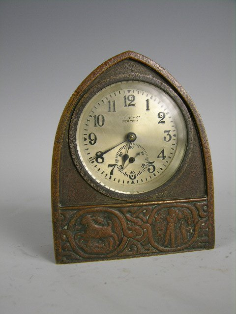 "8: A Tiffany Studios ""Zodiac"" desk clock."