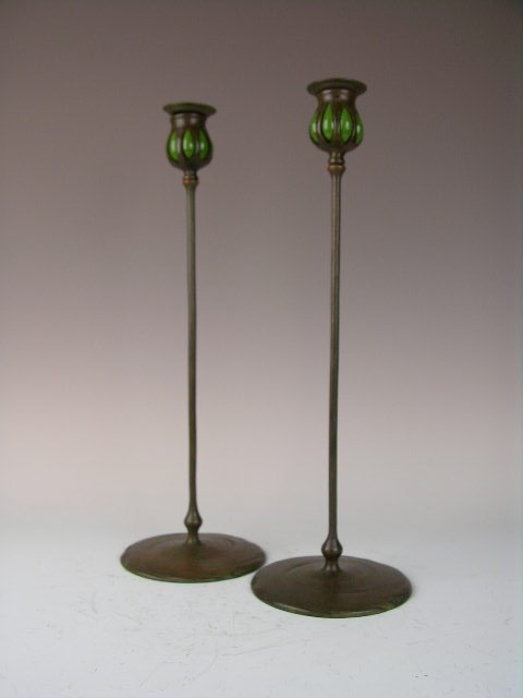 16: Two Tiffany candlesticks with green blown glass.