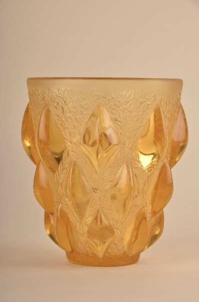 "23: Rene Lalique ""Rampillion"" vase in yellow glass."