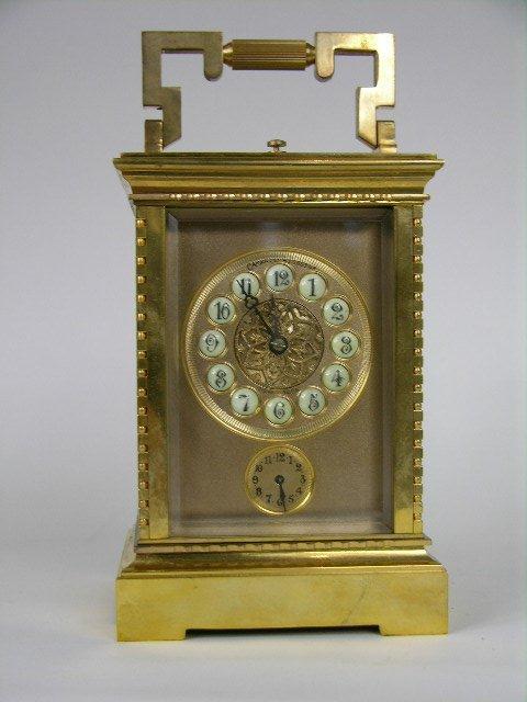 A quarter repeater carriage clock with alarm.