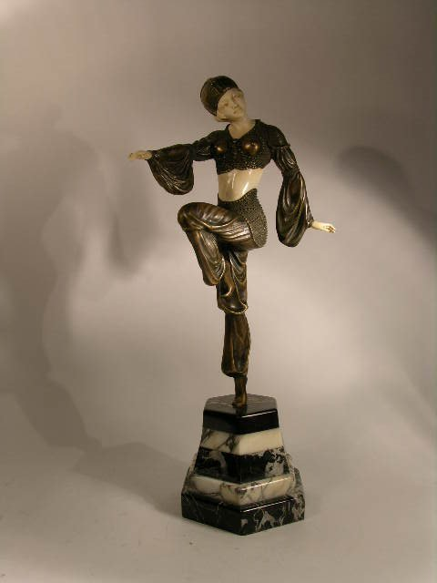 BRONZE AND IVORY FIGURE OF A FEMALE DANCER.