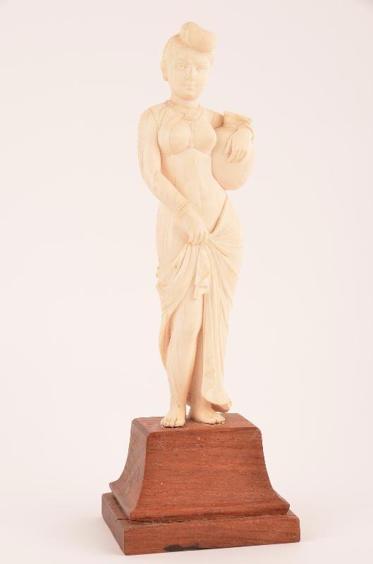 Finely carved elephant ivory figure of a lady on a wood