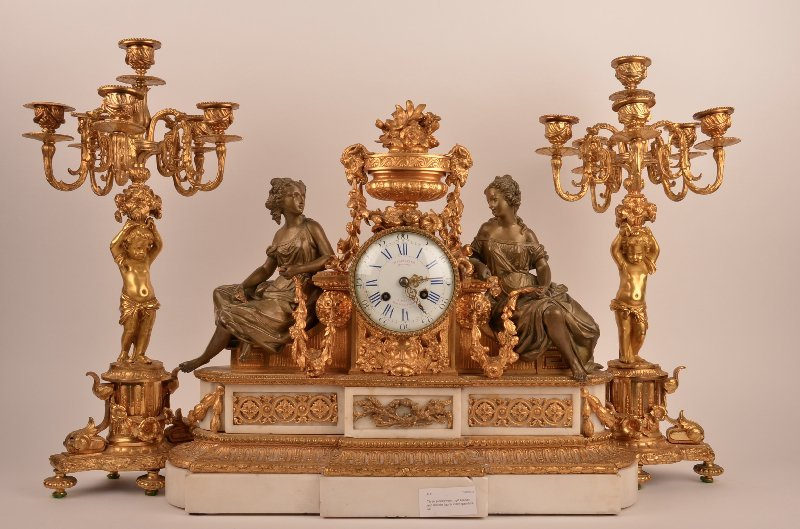 Three piece French gilt bronze and marble figural clock